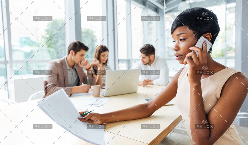 demo-attachment-478-serious-businesswoman-with-documents-talking-on-P9Q6LX6